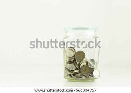 Coin stack in bottle  on white background