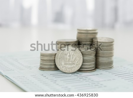 Coin stack on book bank with city in background. Savings, Finance and Banking,  Investment  Concept.