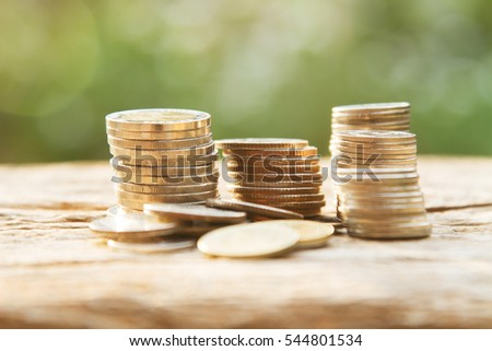 Coin stack on wooden table, Saving and banking concept
