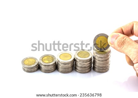 coin stack with hand hold the coin on white background