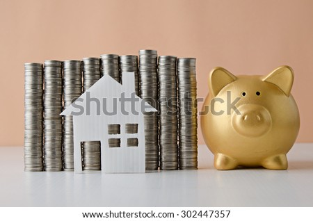 coin stack with house model and piggy bank , Saving plan