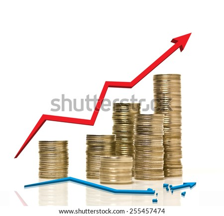 Coin stacks are arraged with growing up red graph and broken blue line graph - stock photo