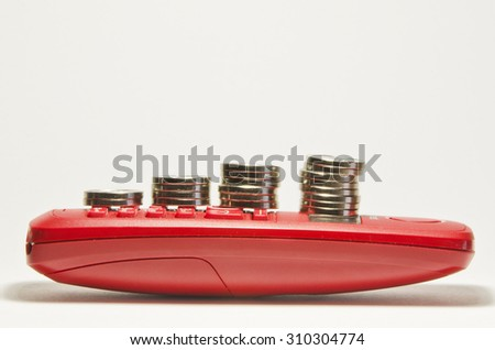 coin stacks on red phone. - stock photo