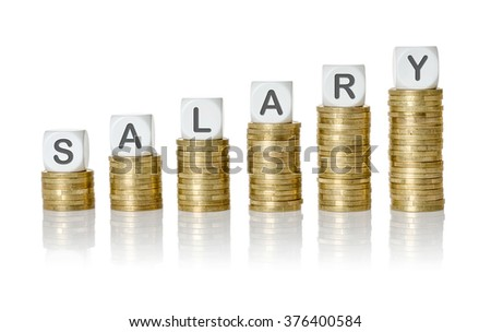 Coin stacks with letter dice - Salary - stock photo