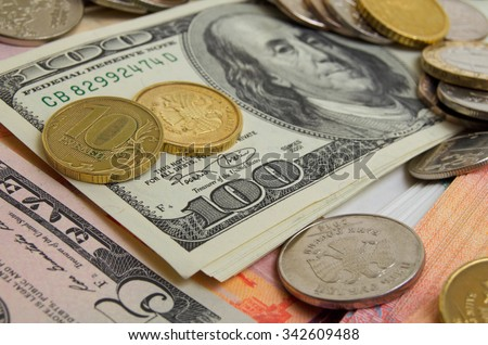 Coins and banknotes of different countries on the plane. - stock photo