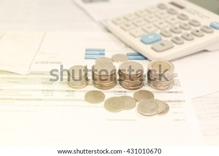 Coins and bill saving for life, Money for income and expenditure saving for tax, Business diagram on financial report with coins selective focus, Vintage style - stock photo