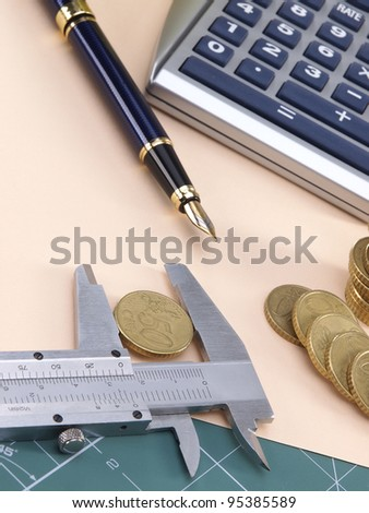 Coins and calculations - stock photo