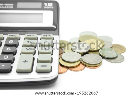 Coins and calculator isolated on white background