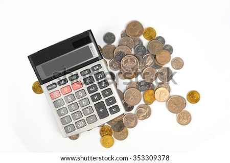 coins and calculator isolated on white background - stock photo