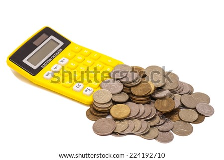 Coins and calculator on white background  - stock photo