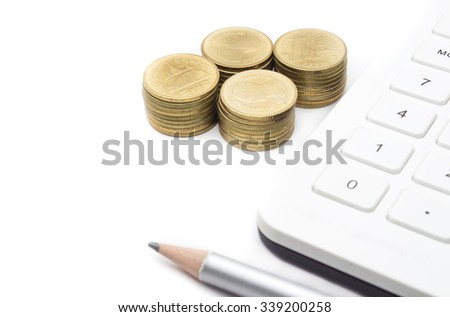 coins and calculator on white background
