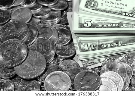 Coins and dollar bills representing wealth and savings