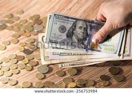coins and dollars - stock photo
