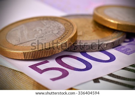 coins and 500 euro banknotes, extra close up - stock photo
