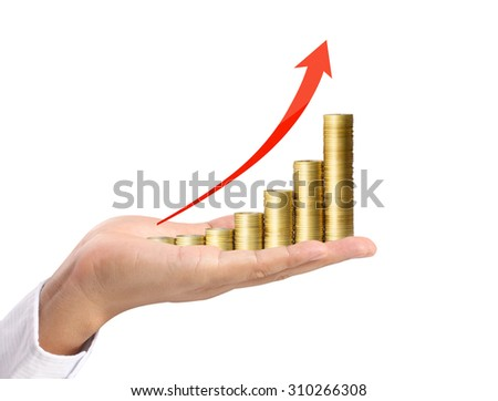 Coins and graph in hand, investment concept - stock photo