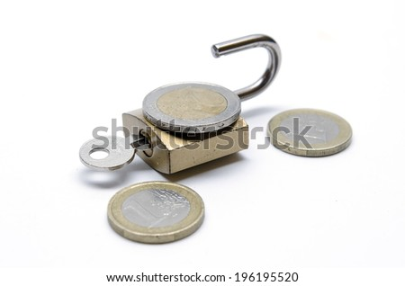 Coins and padlock on white