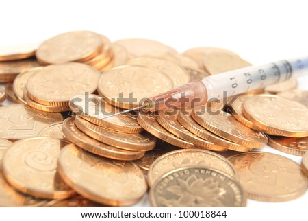 Coins and syringe - stock photo