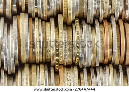 Coins arranged in rows, forms the background - stock photo