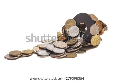 Coins attracted by  magnet isolated on white background - stock photo