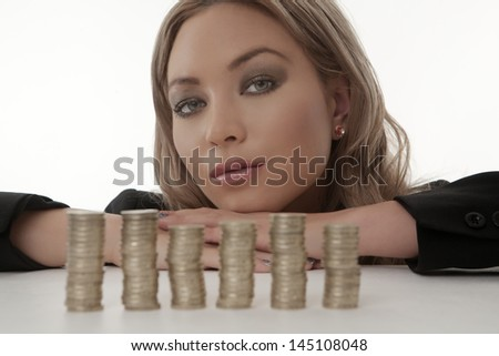 Coins counting woman smiling shot in the studio on while background - stock photo