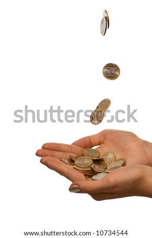 Coins fall in to the girl hands. Isolate on white