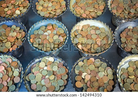 Coins for donations. - stock photo