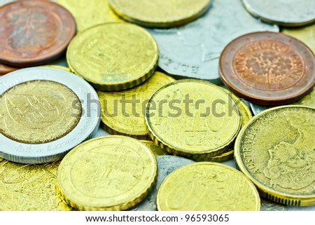 coins form many countries, the imaged is focused on 10 cent Euro coin - stock photo