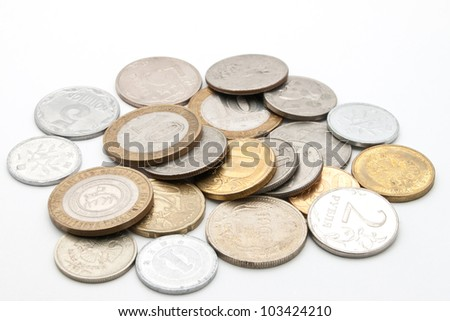 Coins from different countries. - stock photo