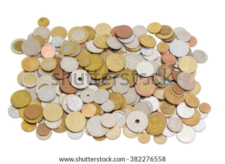 Coins from various countries in circulation at different times on a light background