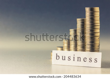 Coins heap stair with Business topic printed on paper - stock photo