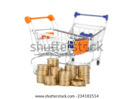 coins in a column on the background trolley from the supermarket.