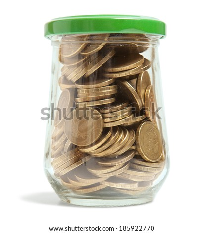 Coins in a glass jar against a white background - stock photo