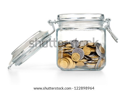 coins in a glass jar with blank label on white background - stock photo
