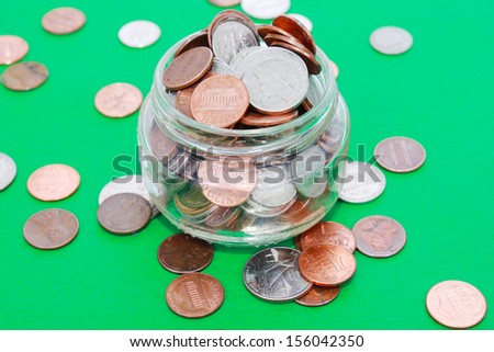 Coins in a jar - stock photo