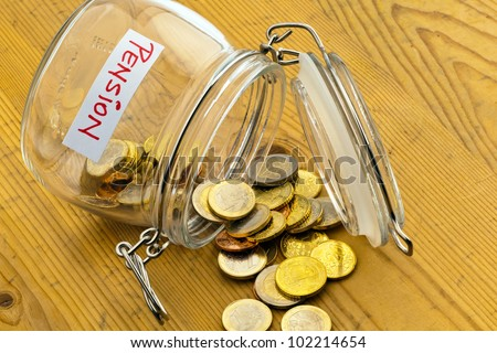 coins in a jar. the provision for old age is always less. poverty in retirement / pension? - stock photo