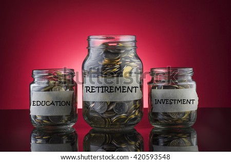 Coins in a jar with label written EDUCATION, RETIREMENT and INVESTMENT on red gradient background - Saving Concept