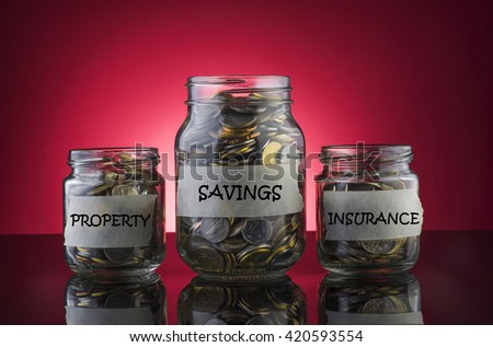 Coins in a jar with label written PROPERTY, SAVINGS and INSURANCE on red gradient background - Saving Concept