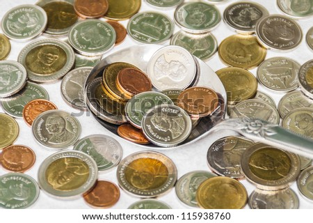 Coins in a spoon - stock photo