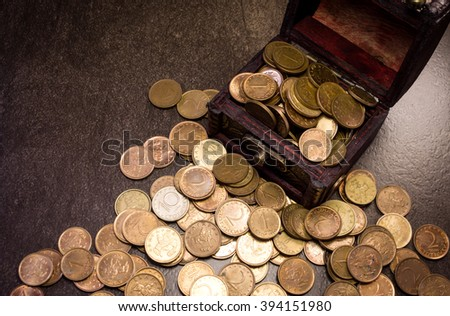 Coins in and out of wooden box