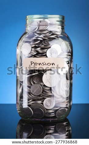 Coins in bottle with label Pension - financial concept  - stock photo
