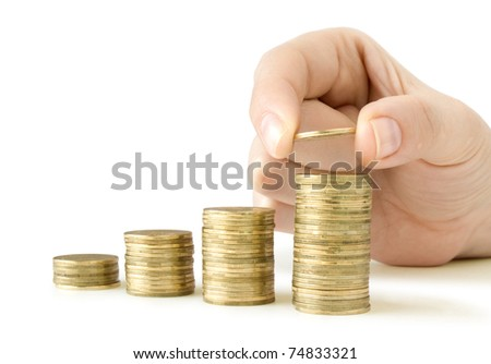 coins in finger and row stacks them isolated on white - stock photo