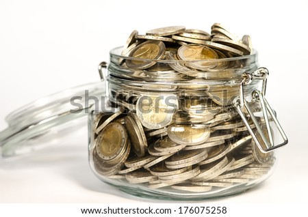 coins in glass on white background - stock photo