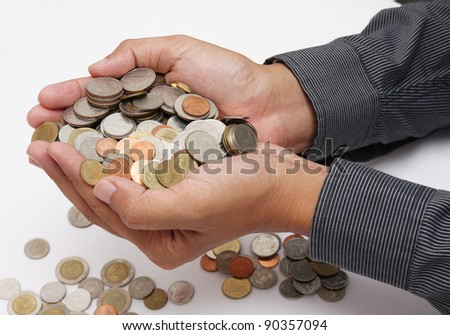coins in hands - stock photo
