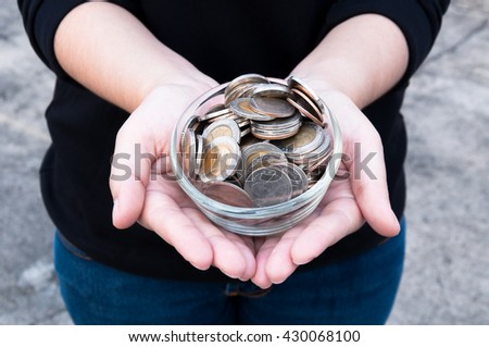 Coins in hands saving,Donation Investment Fund Financial Support Charity  Dividend Market  House Stock Trust Wealthy Giving Planned Accounting Collection Debt Banking ROI - stock photo