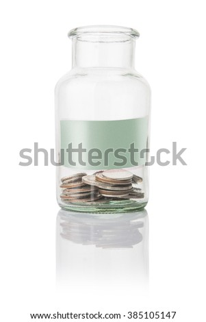coins in jar with paper , saving money