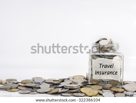 coins in jar with travel insurance label in isolated white background; financial concept - stock photo