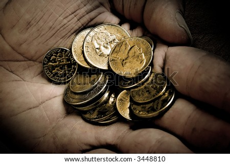 Coins in old dirty hands. Short DOF. - stock photo