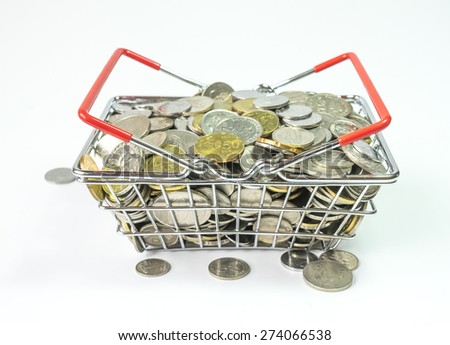 Coins inside basket - stock photo