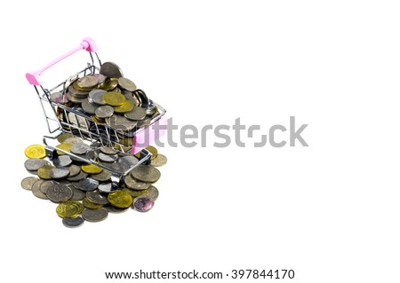 Coins inside mini trolley with white background - stock photo