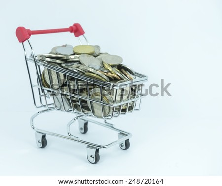 Coins inside toy trolley with white background - stock photo